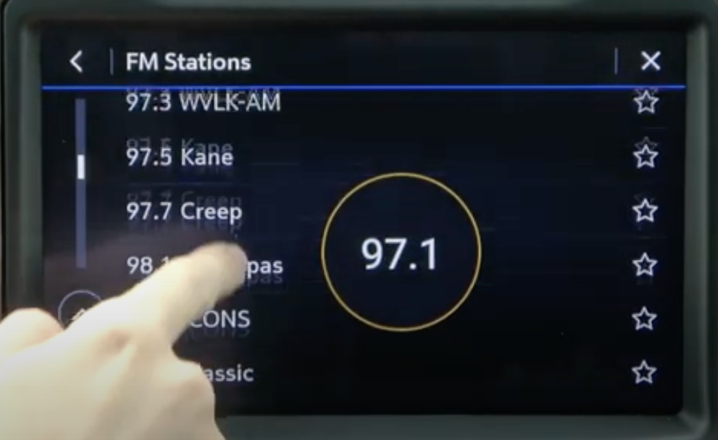 Scrolling through a list of FM stations and whichever is selected appears as a bigger number outlined by a circle