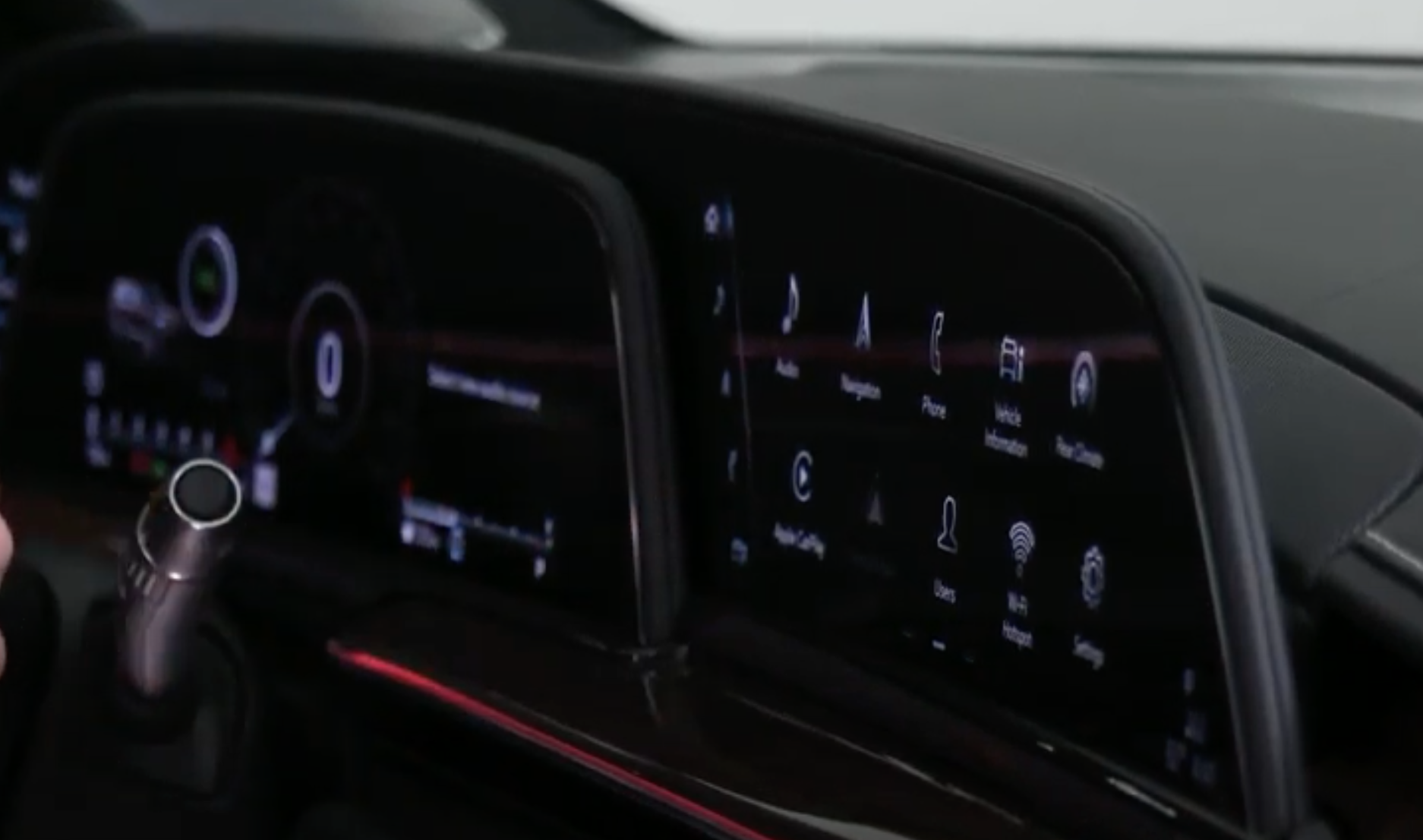 A photo of the touch surfaces of the infotainment system with the gauge cluster