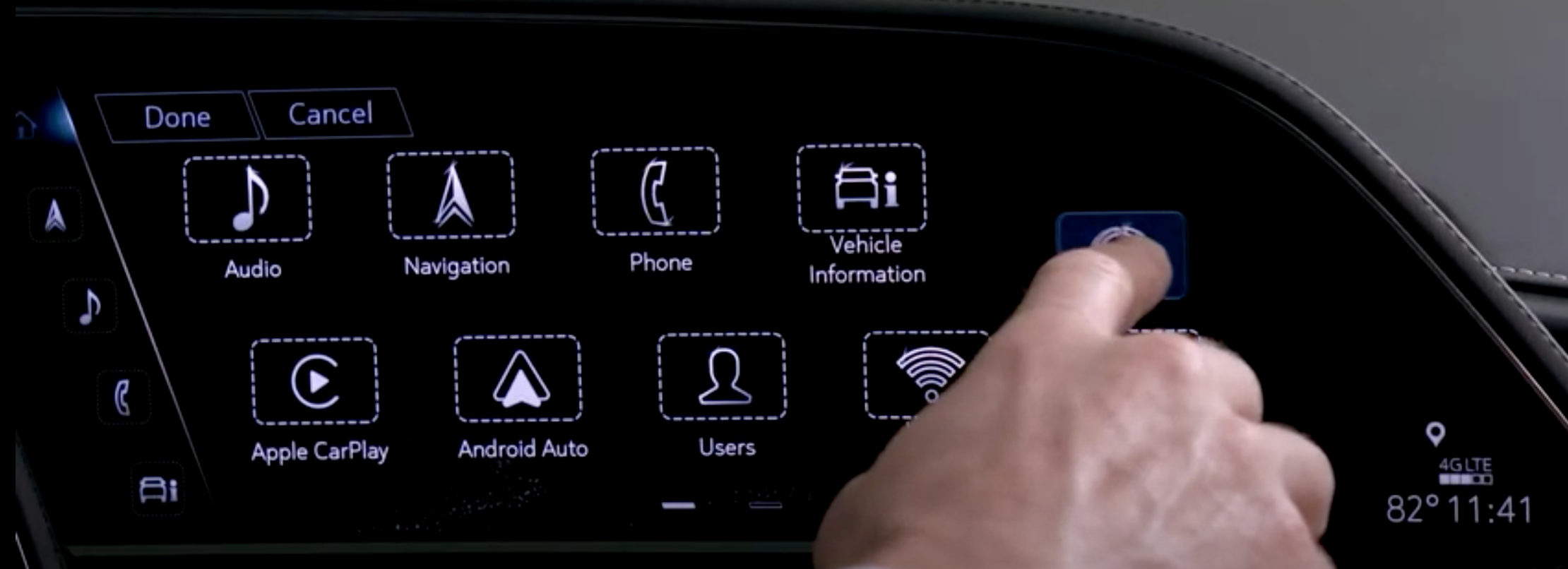 A user customizing the order of apps on the infotainment screen by dragging them to the desired location
