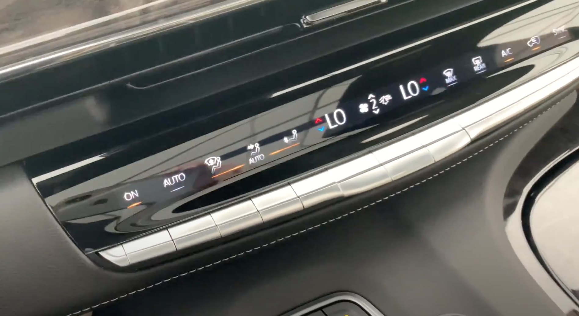 Physical buttons underneath the infotainment system