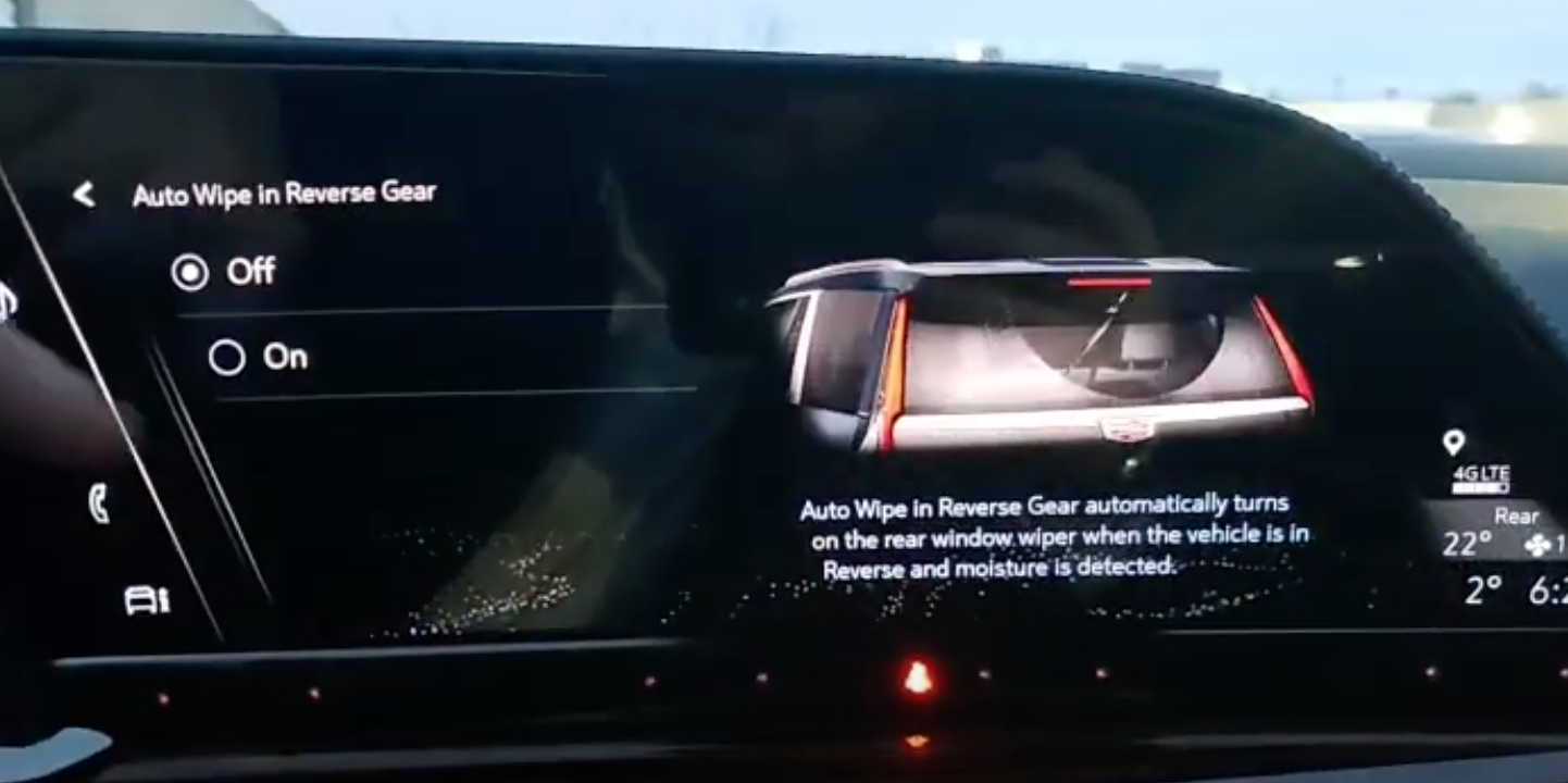 Turning on and off auto rear wipers and an illustration of the rear wipers on the right