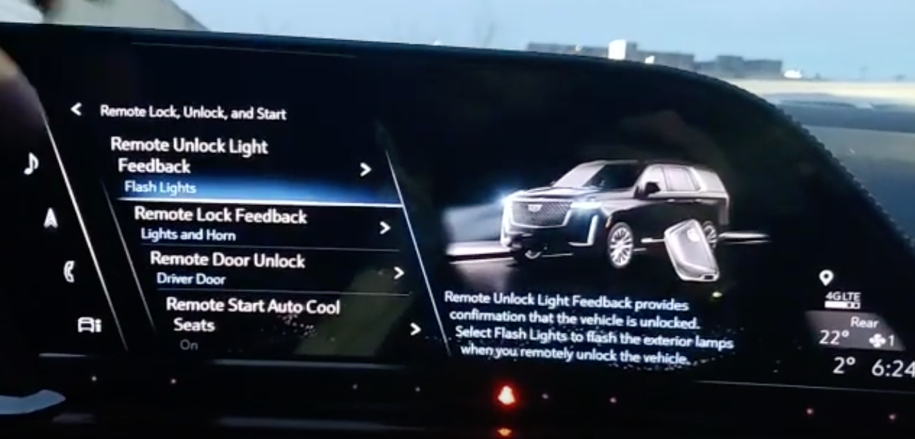 A list of various settings related to remote locking/unlock and starting, feedback light selected to give turn on high beams when vehicle is unlocked