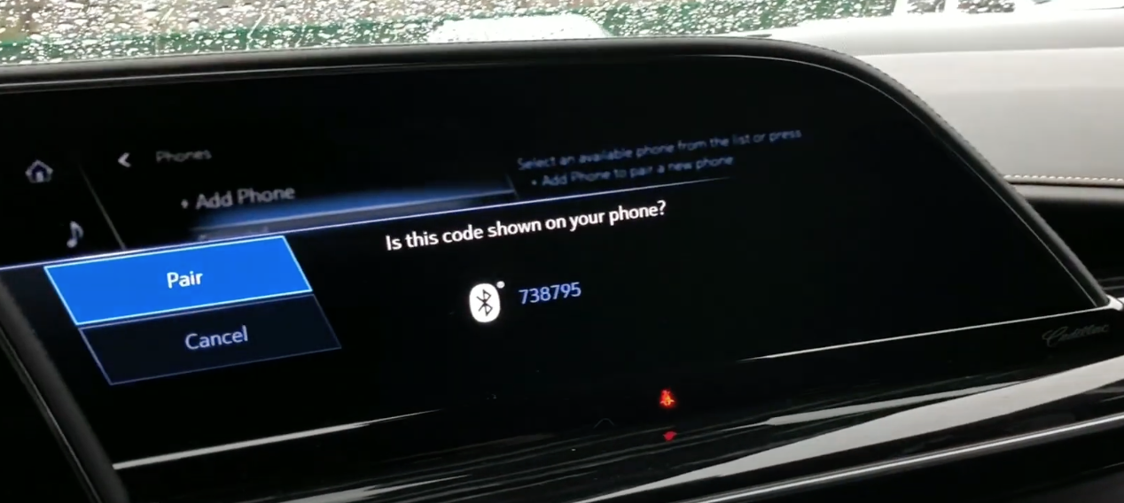 Screen displaying a Bluetooth code on the infotainment screen so a user can pairing it with their phone