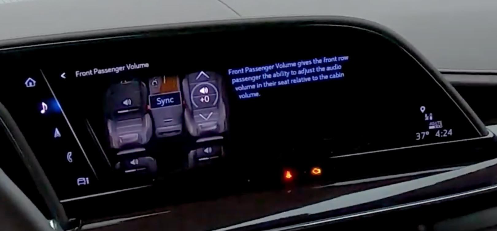 Adjusting the front passenger seat volume through an illustration of the front seats