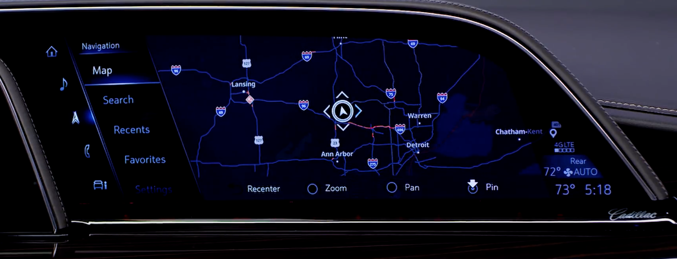 How the map looks on the navigation system with the options to re-center, zoom, or pin