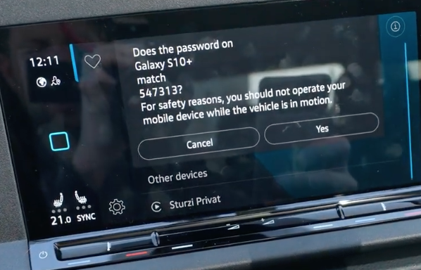 A code displayed on the infotainment screen to pair a user's phone to the vehicle through Bluetooth