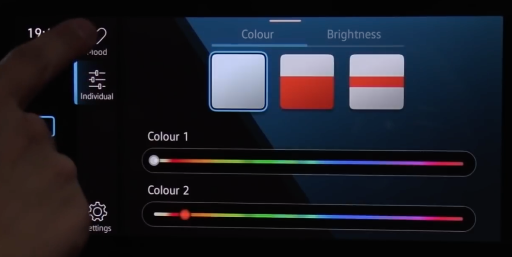 Choosing the theme and colors for the interior lighting of a car through sliders
