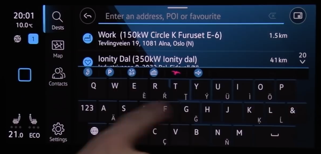 Searching for an address with a search bar, small point of interest icons and a digital keyboard to enter address
