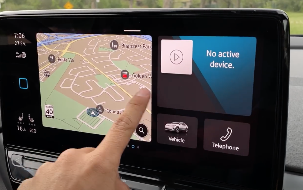 A view of the home screen of the infotainment screen divided in uneven sections, navigation being the biggest then there is phone and settings