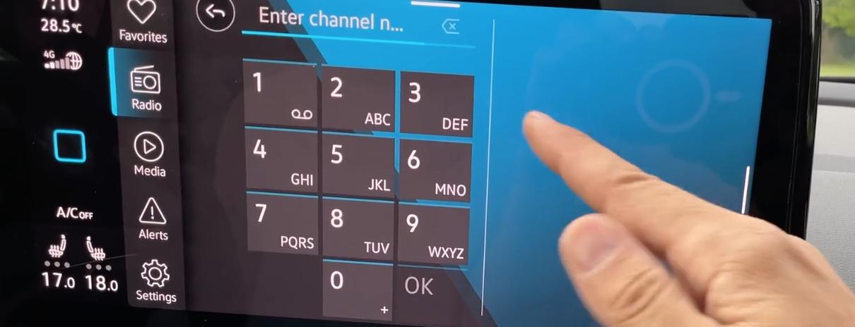 Manually tuning a radio channel through a digital keypad