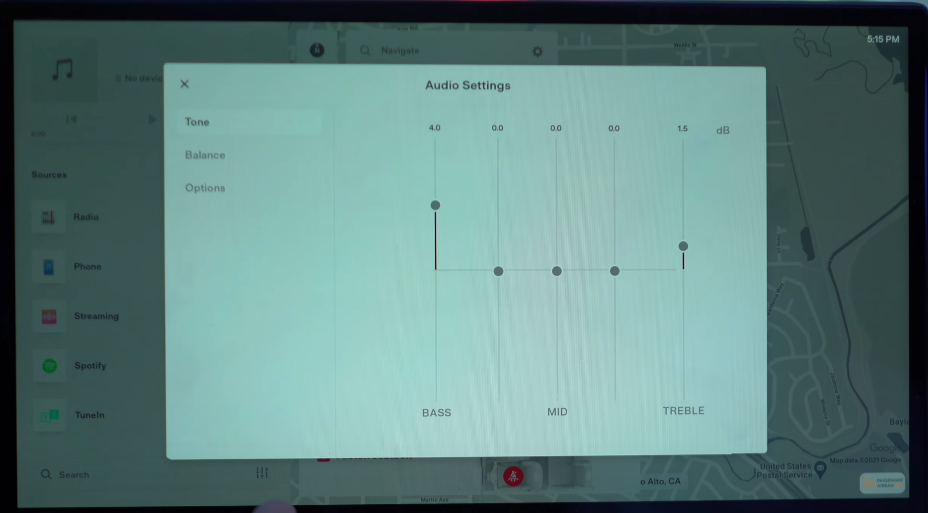 Adjusting the audio settings such as treble and balance through sliders