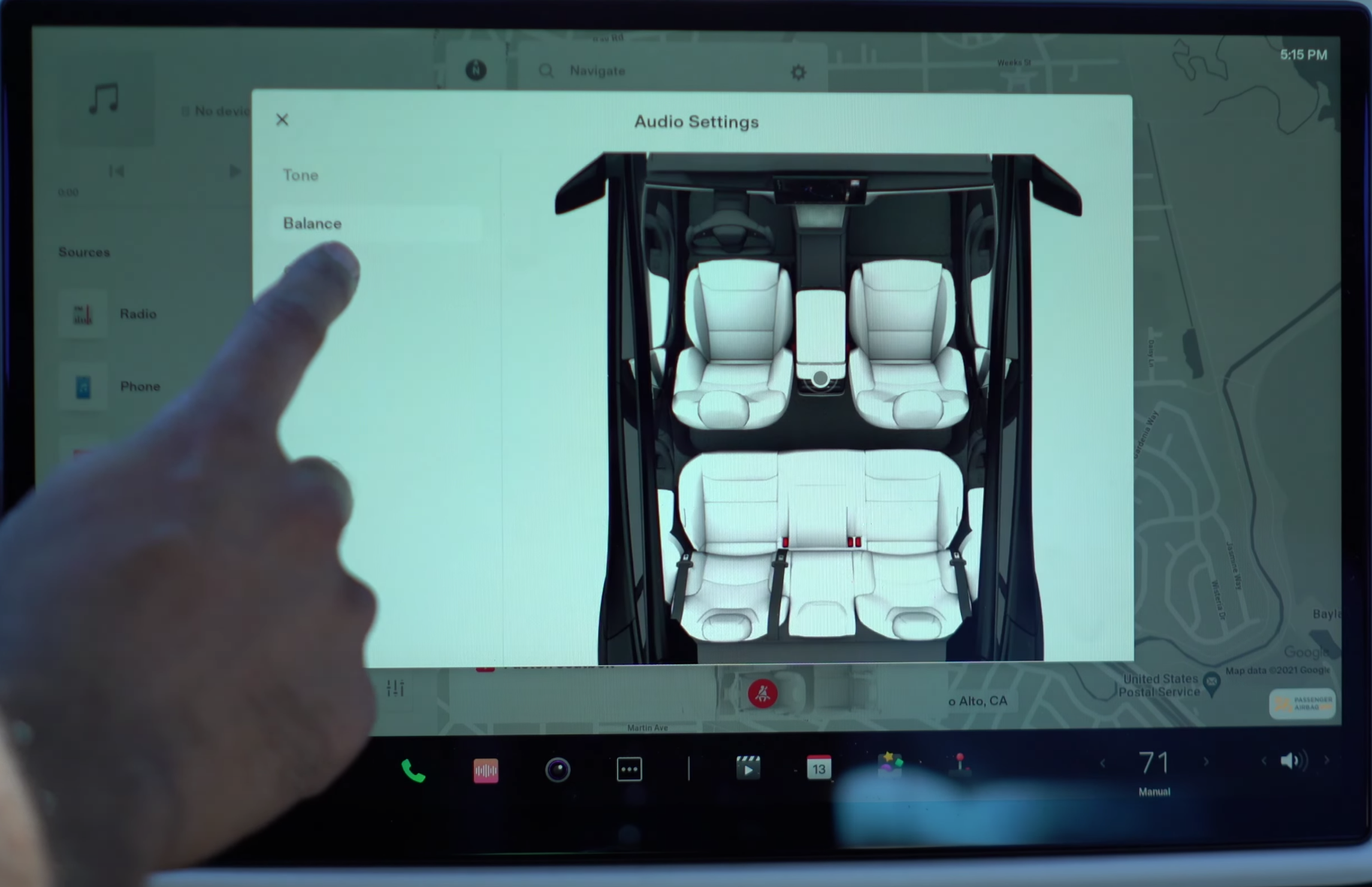 Adjusting the balance for media settings through an illustration of the interior of the vehicle