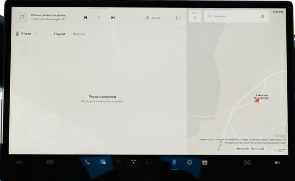 A screen letting a user know that a phone is connected to play media from however there are no playlists available and a view of the map on the right