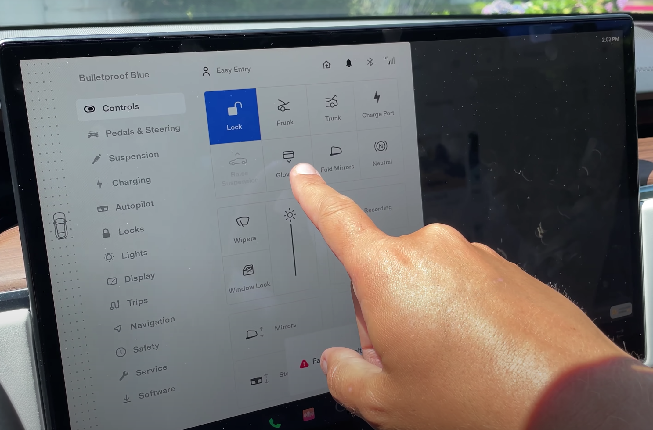 Opening the glovebox of a car through a digital button on the infotainment display