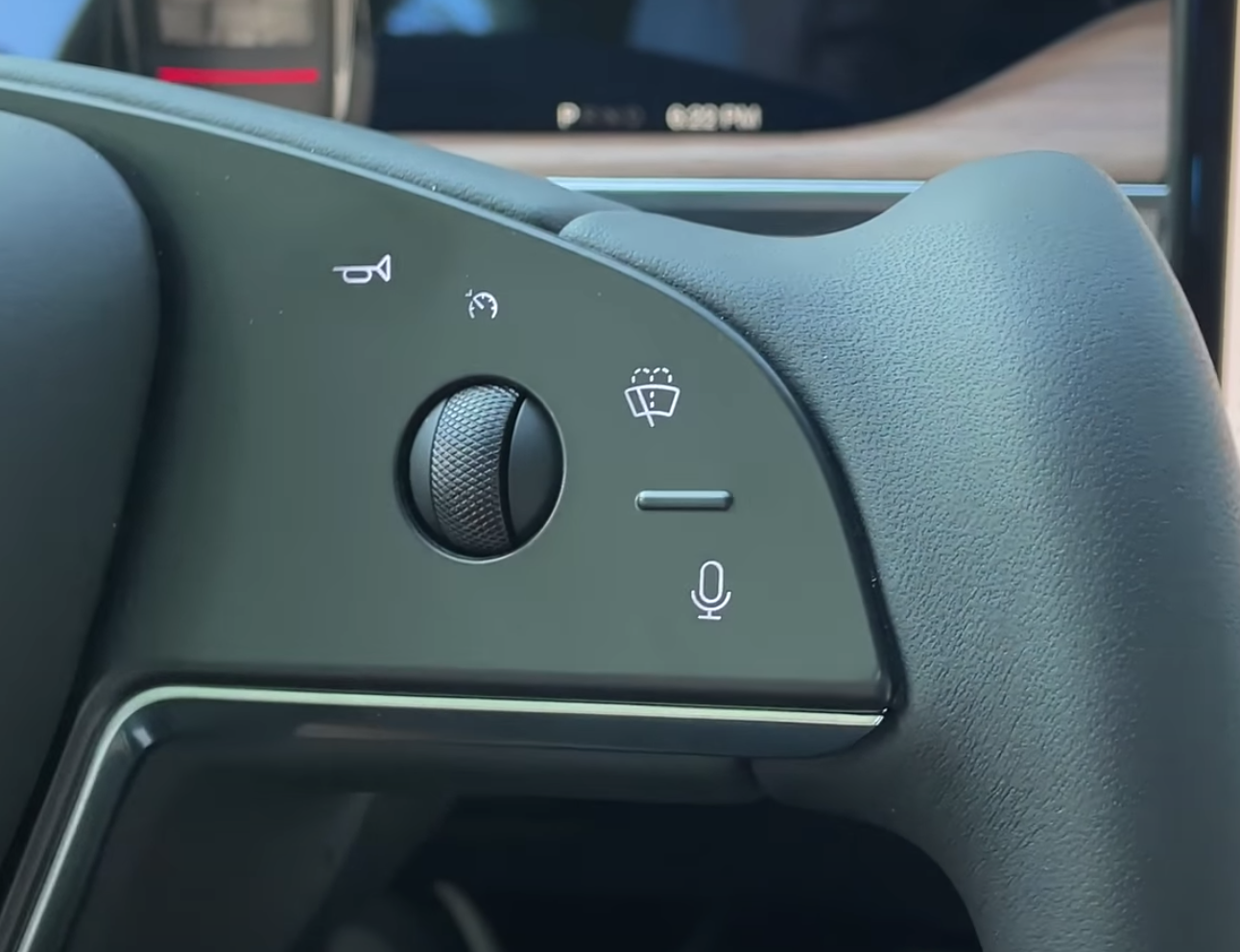 A photo of the buttons and dials on the steering wheel