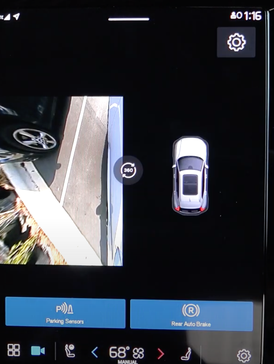 A view of the 360 camera view on the infotainment system with a 3D model of a car on the right