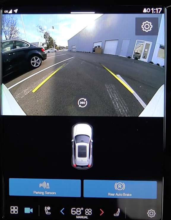 A view of the rearview camera view on the infotainment system to assist with parking with a 3D model of a car