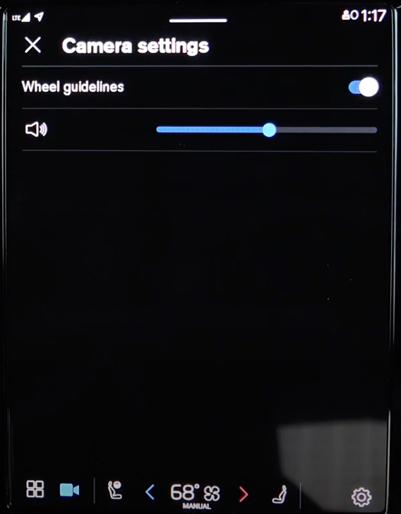 Setting up the camera settings such as turning on and off wheel guidelines with a toggle and setting up sound settings through a slider