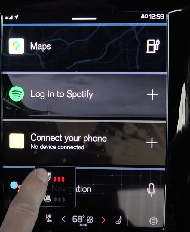 Setting the steering wheel temperature from a small steering wheel icon at the bottom of the screen