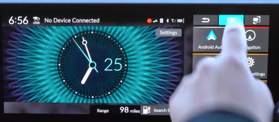 Big analog digital clock on the infotainment system with the menu on the right
