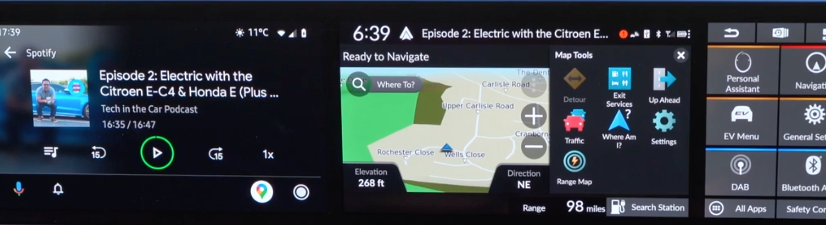 Map view on the right screen with navigation tools and Android Auto Spotify display on the left screen