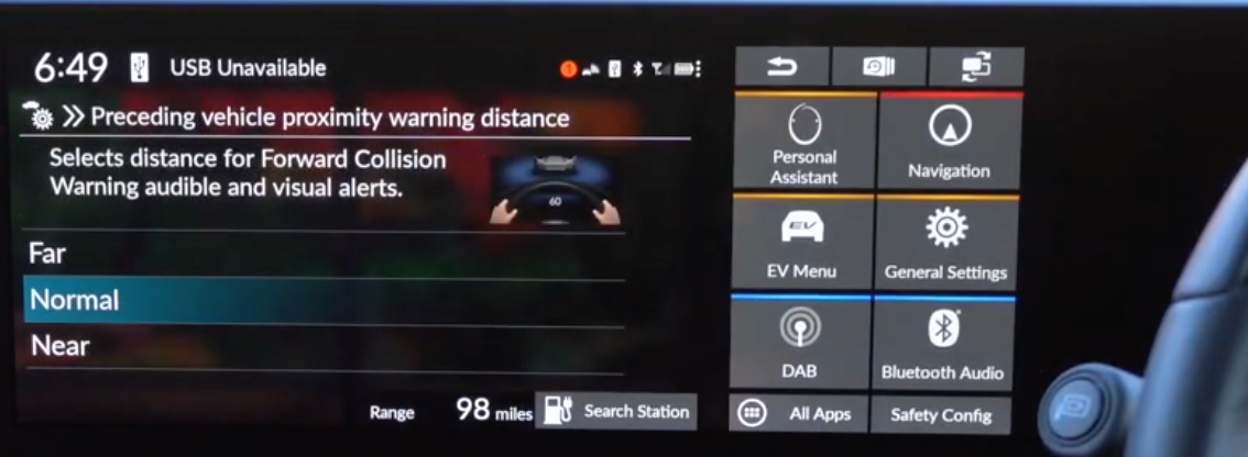 Setting up the collision avoidance settings to be far, normal or near with an illustration of hands holding a steering wheel