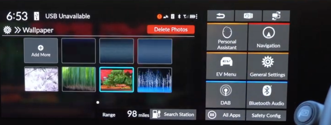 Chosing a wallpaper from a gallery of options for the infotainment display