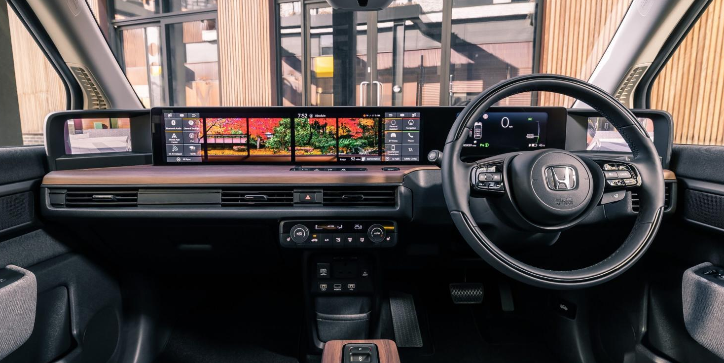 Photograph of the inside cabin of the vehicle showcasing all the touchscreens