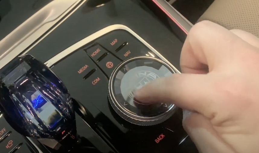 Photograph of the dials and buttons next to the driver with a dial where the surface can be used to draw letters with fingers