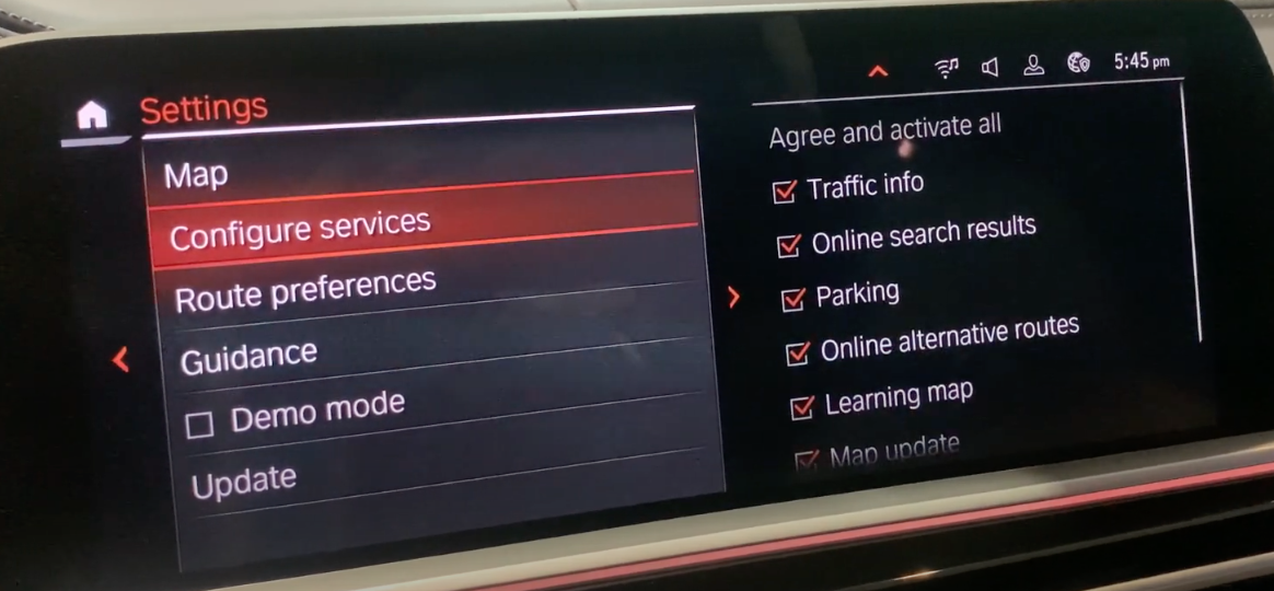 A list of navigation settings on the left and a list of services to activate on the right such as parking and traffic info