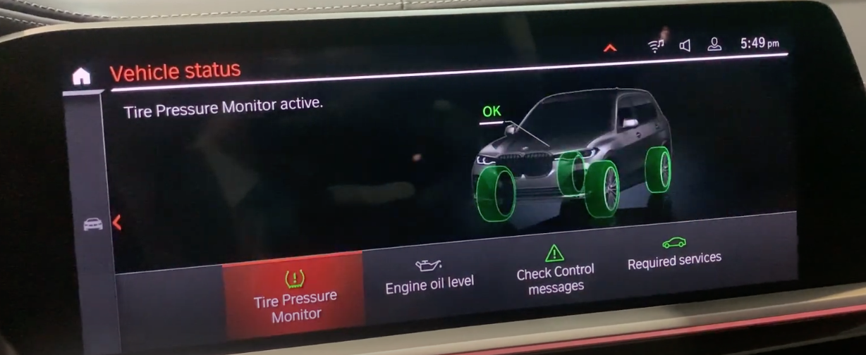 Tire pressure monitor feature selected with a 3D model of a car with tires highlighted