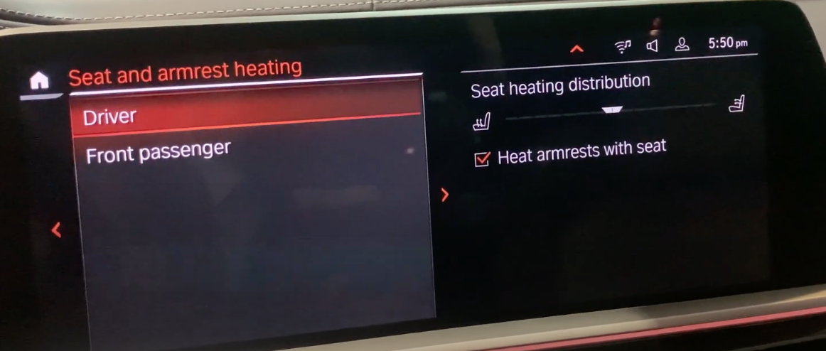 Seat and armrest heating settings page with a slider to set up seat heating distribution