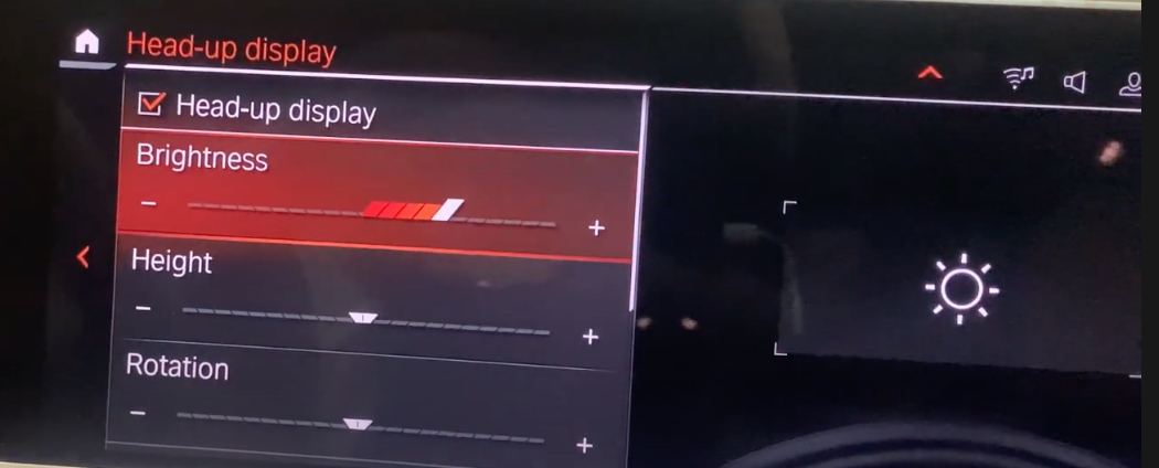 Adjusting the brightness of the heads-up display through a slider