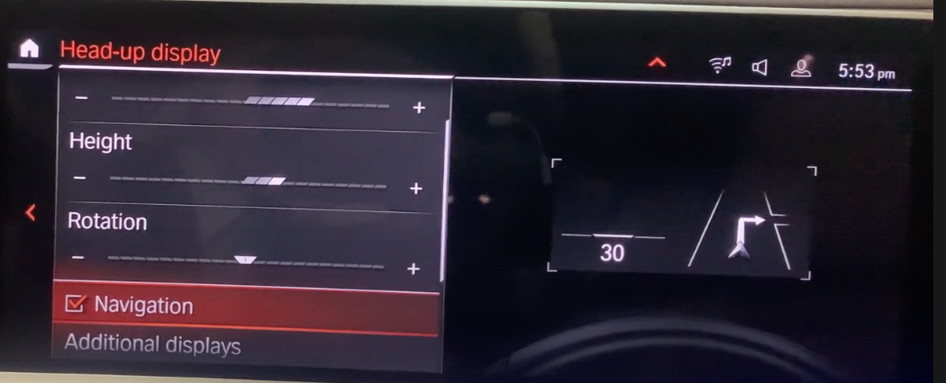 Adding navigation features to the heads-up display through the infotainment screen
