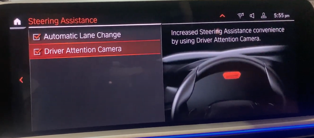 Turning on and off automatic change lane and driver attention camera with an illustration of a steering wheel on the right