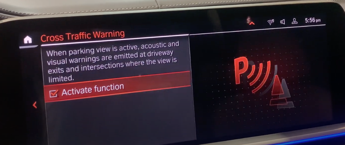 Activating cross traffic warning feature with an a big P icon indicating parking