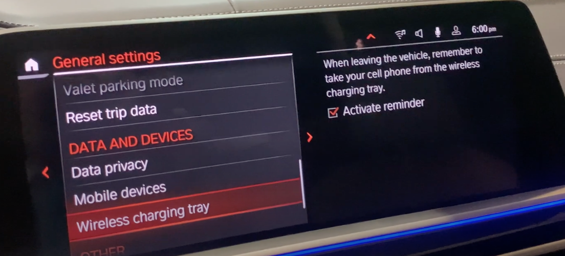Wireless charging tray selected from a list of various vehicle settings