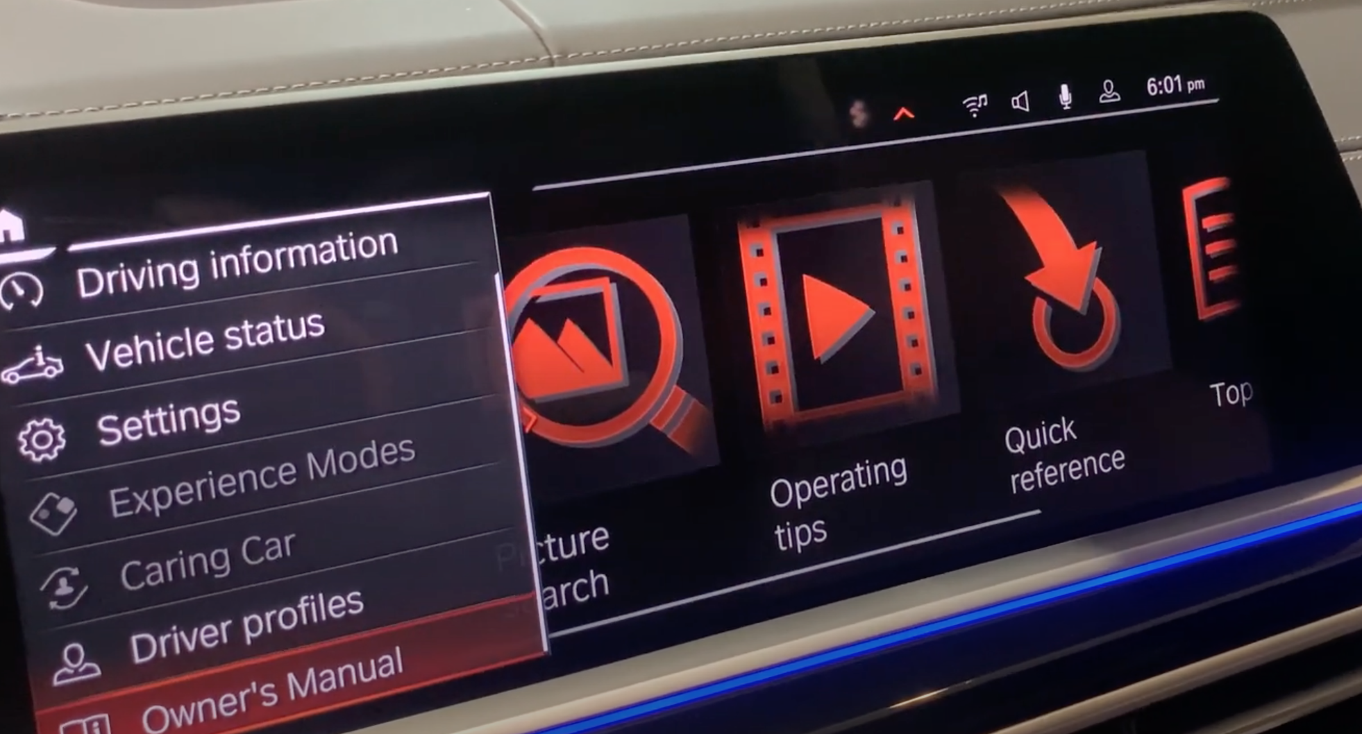 Owner's manual chosen from a list of vehicle information options with icon that represent ech category on the side