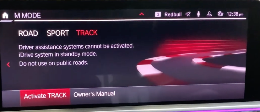 The track driving mode page with a background image and the option to activate or see owner's manual
