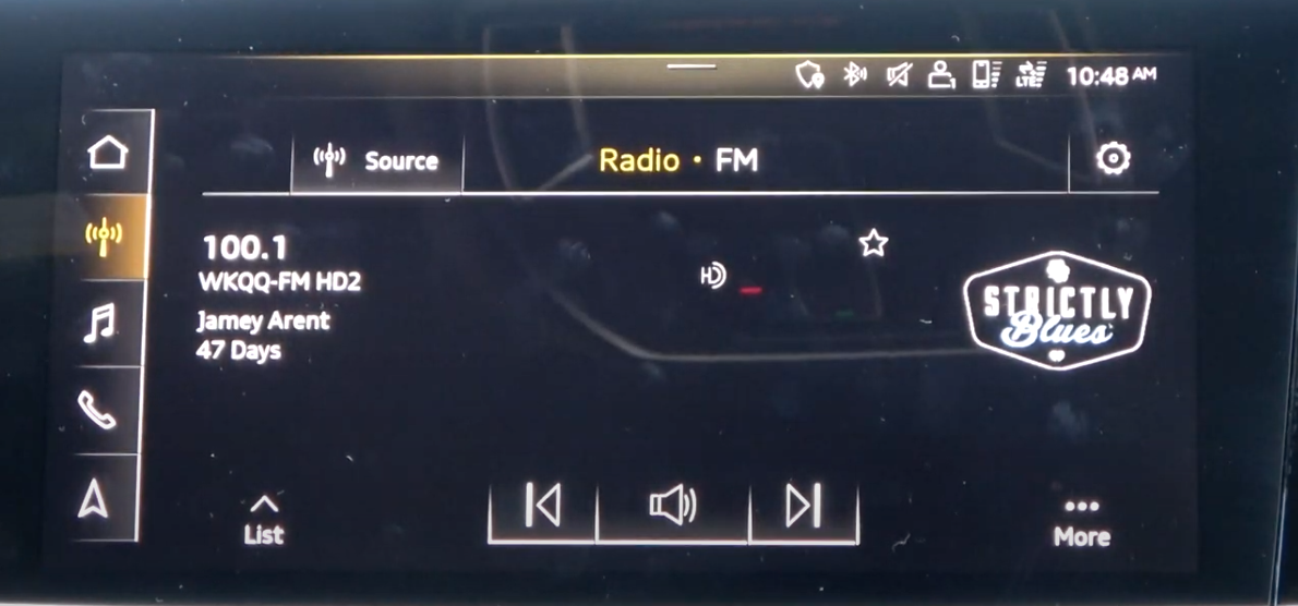 Media player screen with what is currently playing, back and forth and volume icons.