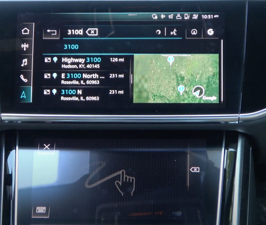 Upper screen displaying a route preview and options while the bottom screen has a gesture illustration to indicate that a user can draw letters to input an address