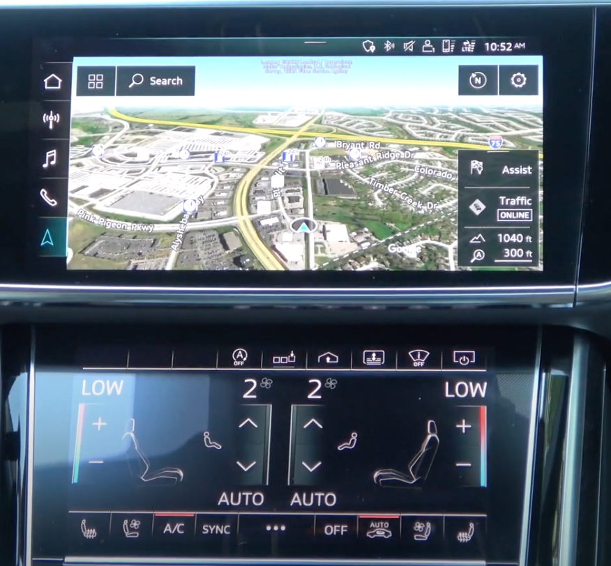 While a map view is being displayed on the top screen, the bottom one shows the climate control and seat temperature settings