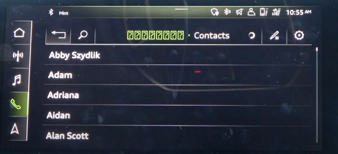 A list of contacts from the phone book displayed on the infotainment screen