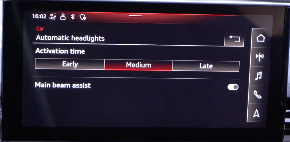 Setting up the activation for the automatic headlights to be either early, medium or late and turning on and off high beam assist through a toggle