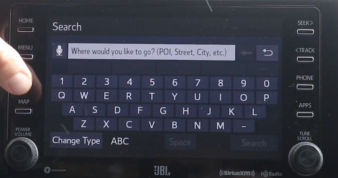 Digital keyboard to enter an address within the navigation system