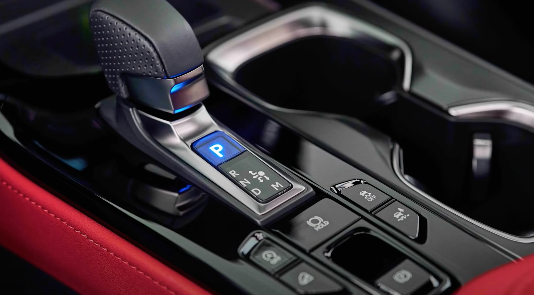 Photograph of the stick shift along with other buttons of the vehicle