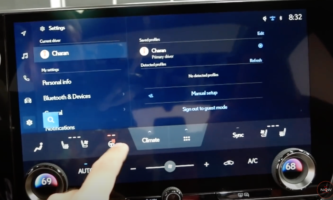 Adjusting the steering wheel heat through a small steering wheel icon at the bottom of the screen along with other climate controls