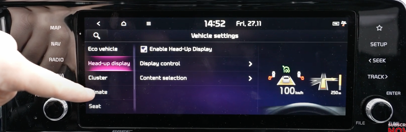 From a list of settings head-up display option selected with illustration of features that are displayed on the windshield