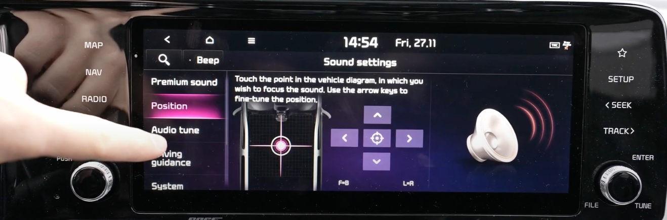 Adjusting the balance of the sound system through a vehicle diagram