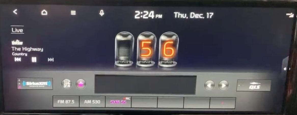 Radio screen with a small star icon to add favorite stations with numbers inside individual bulbs indicating the station number that is currently playing